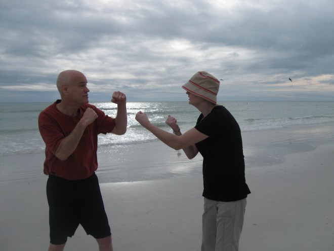 Posing for a vacation photo on Florida's Siesta Key beach a few years ago by playfully punching around