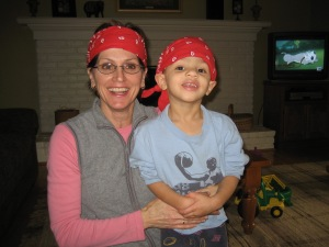 Mom and Ryan in red headbands