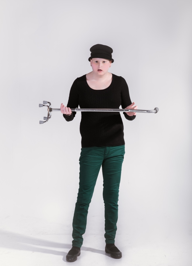 Holding cane sideways wearing hat.jpg